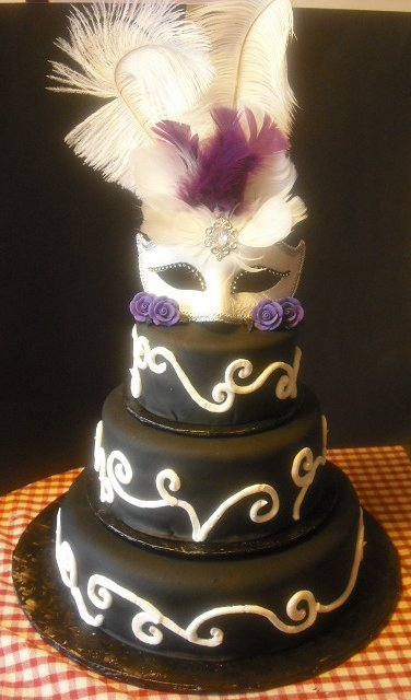 I just added some purple feathers and roses to keep with the wedding colors